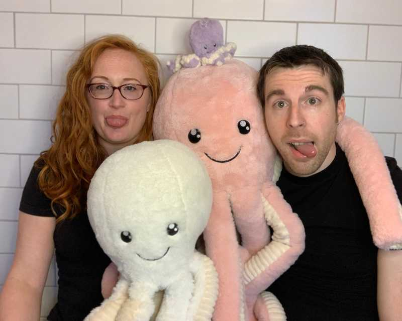 Sarah and Matt surrounded by stuffed octopuses.